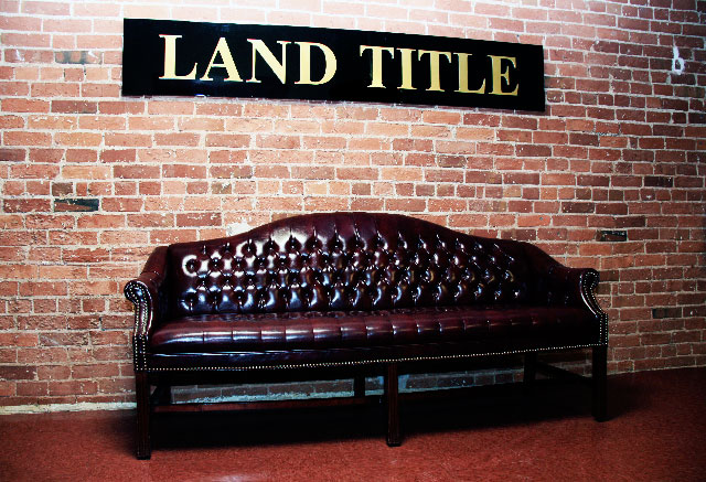 image of a leather couch in the Land Title offices